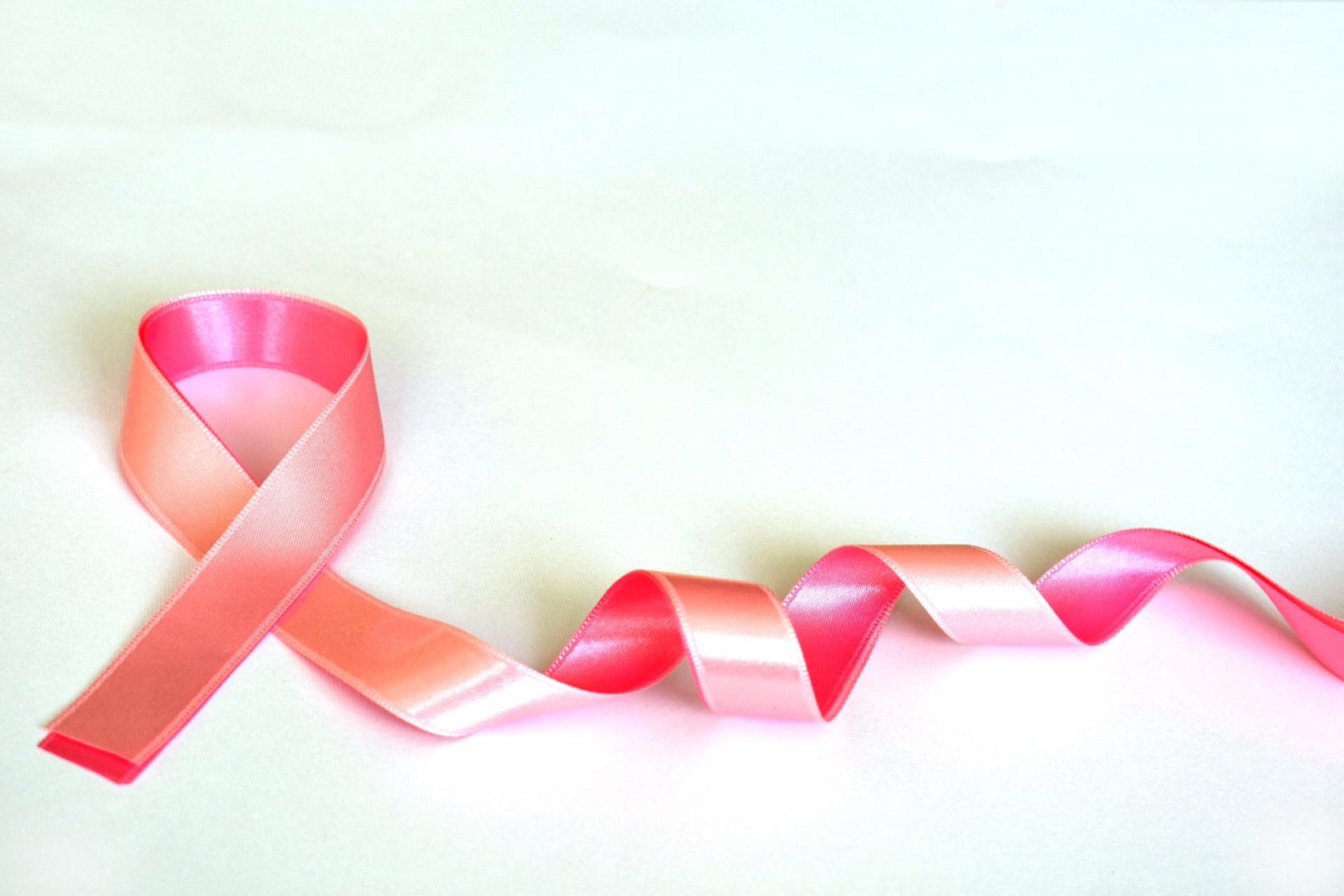 pink ribbon making cancer support symbol